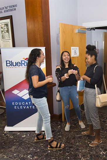 Three female students talking