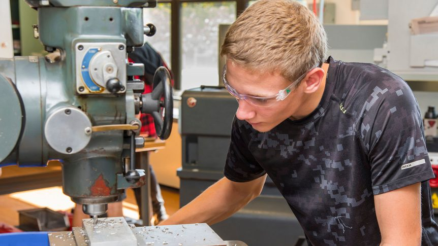 Student milling metal