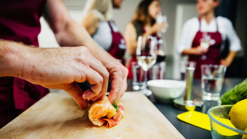 Hand folding meat in a cooking class