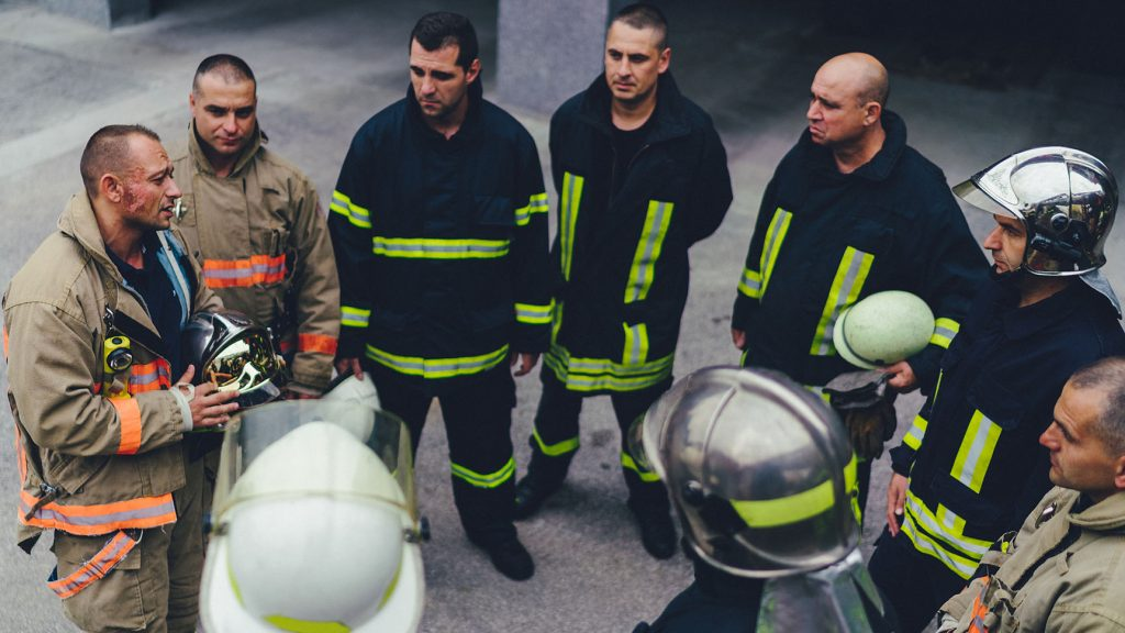 Team of firefighters listening to instructions