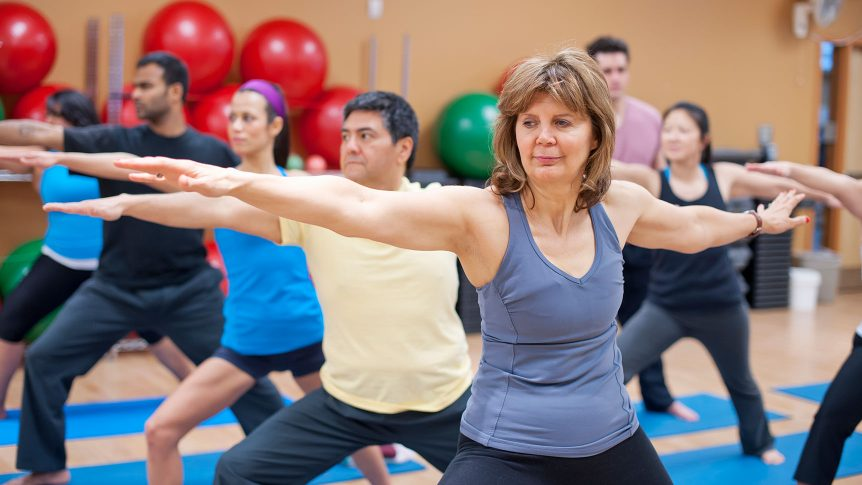 People practicing yoga in studio