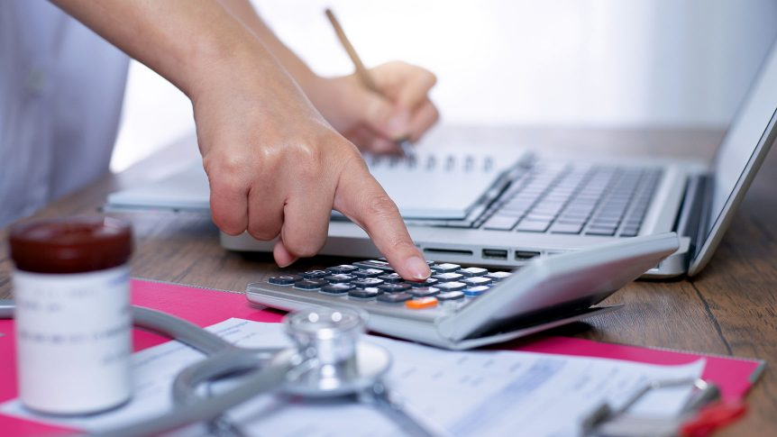Medical worker calculates the cost of treatment