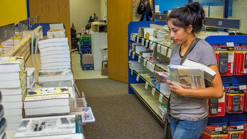 A student searches for textbooks in the campus book store