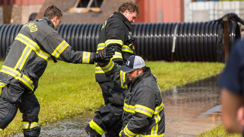 a fire and rescue student high fives his instructor