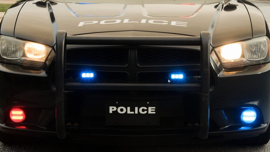 Front end of police car with lights flashing