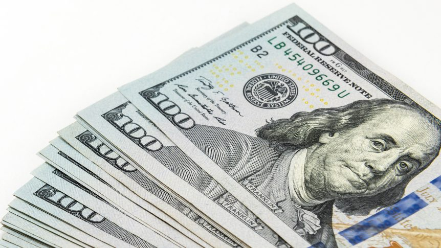 stack of hundred dollar bills up close