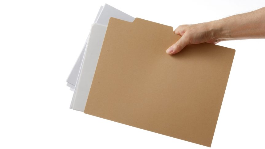 hand holds file folder with papers
