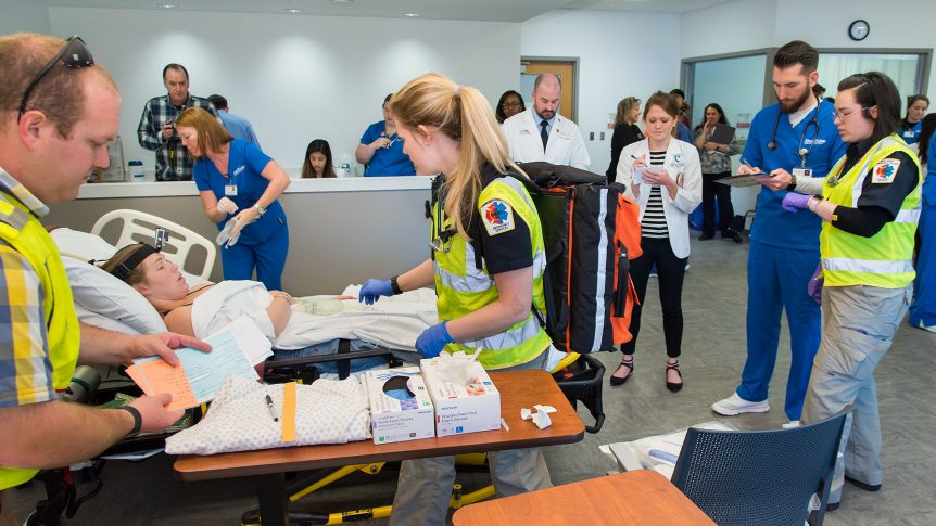 A simulation lab full of students of various health care related disciplines from Blue Ridge community college and Wingate University work together