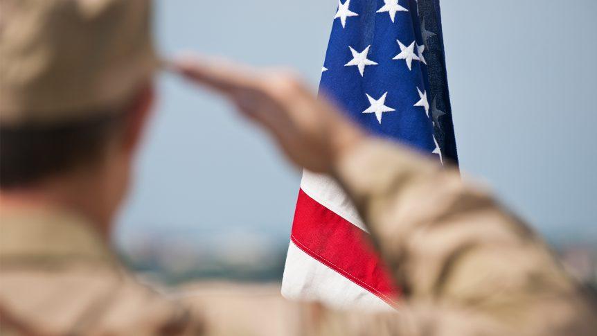Veteran salutes American flag