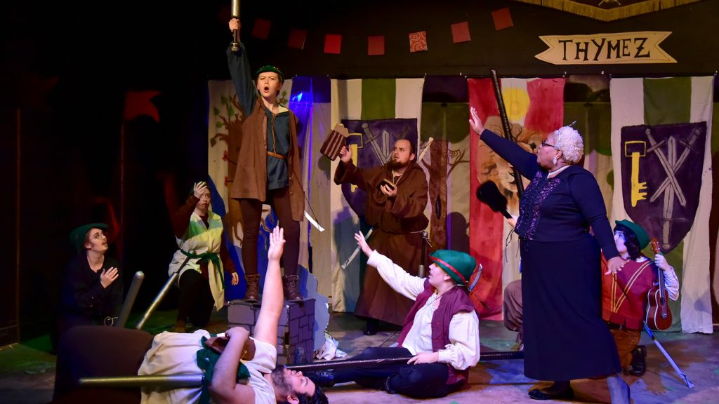 a scene from a theatrical performance of Robin Hood