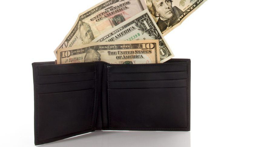 wallet with money bills coming out of it