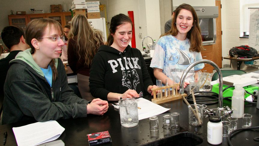 a group of students working in a biology lab