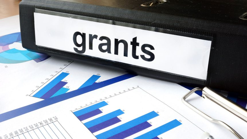 Folder with the label grants and charts