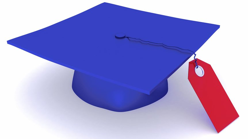 A graduation cap with a red tag hanging off of it