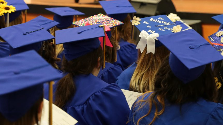 a group of graduates in their caps and gowns