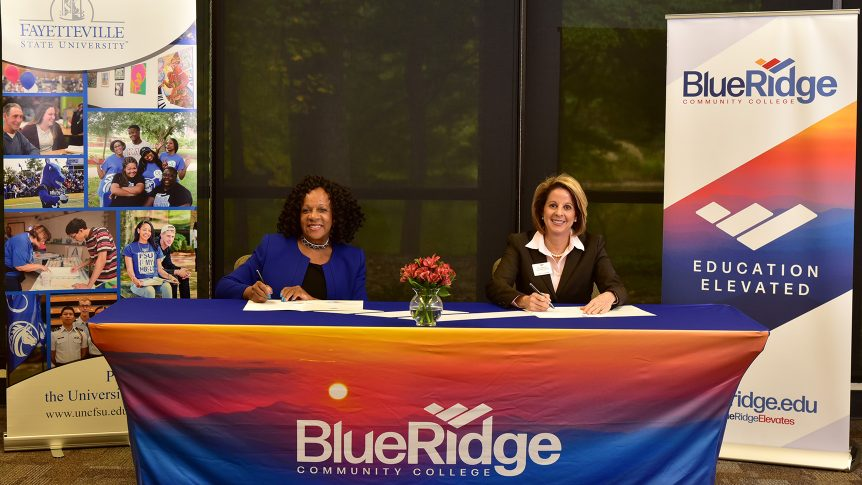 The president of Blue Ridge and a representative from Fayetteville State sign an articulation agreement