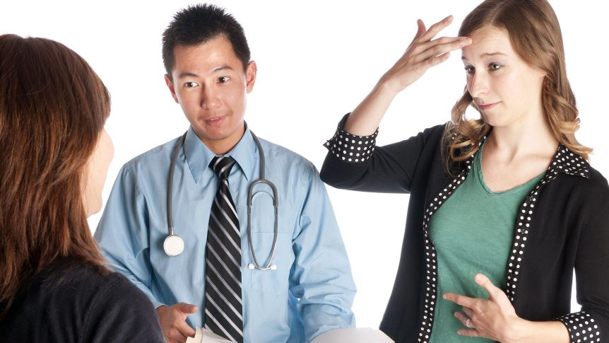 Sign Language Interpreter and Patient with Asian Doctor