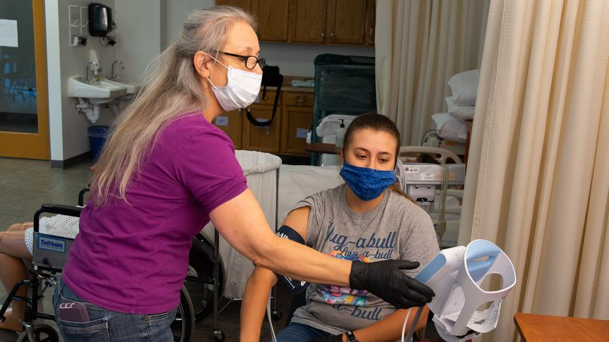 two Psychiatric Tech students working on taking vital signs