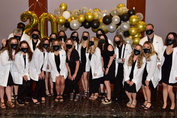 Group of nursing students in front of balloon arch