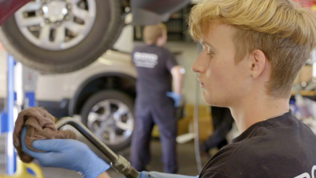 Automotive apprenticeship student Carter Hamrick works with tool